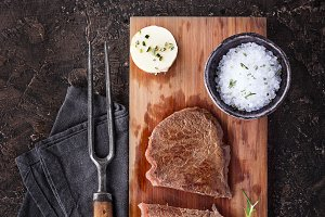 Grilled steak with herbs and salt