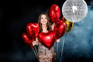 Beautiful woman with shiny balloons