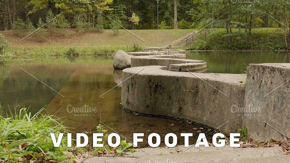 Concrete Walkway Through The River Autumn Daytime Smooth Dolly Shot