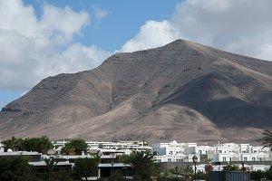 volcano over buildings