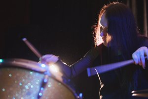 Passionate girl with long hair - percussion drummer perform music break down - teen rock music