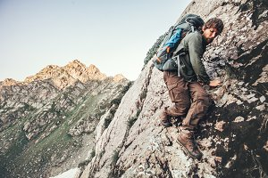 Man climbing rocky mountains