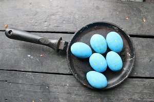 Easter eggs in a frying pan. Creative concept.