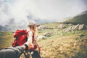 Couple travelers at foggy mountains