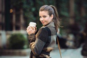 businesswoman holding coffee