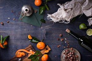 Oranges with leaves, hazelnuts, wine