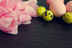 Easter background with colorful eggs and pink tulips