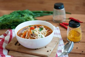 Asian traditional soup lagman with noodle and meat