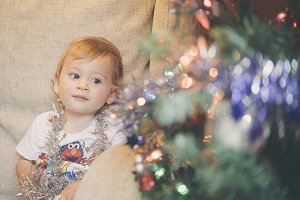 A children with christmas tree