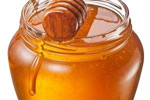 Glass can full of honey