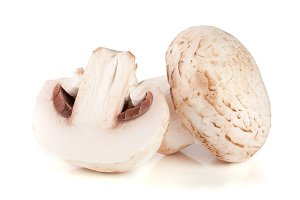champignon mushrooms and half isolated on white background
