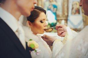 Bride drinks holy wine