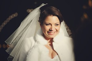 A picture of smiling brunette bride
