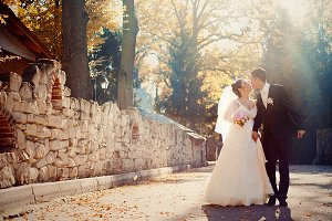 Autumn sun shines over the couple