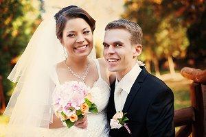A portrait of happy wedding couple