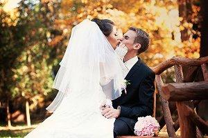 Bride sits on groom's knees