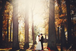 Bride and groom in the autumn forest