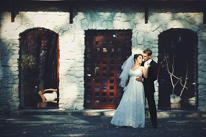 Handsome man hugs a bride