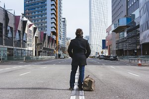Man standing alone in the street