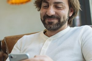 Young man checking his phone