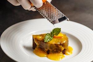 Chef rasping orange zest