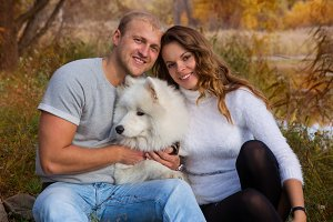 Couple and dog Samoyed