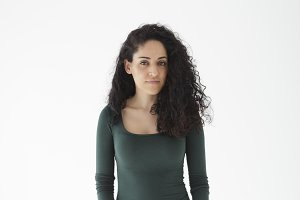 Natural brunette girl on neutral background