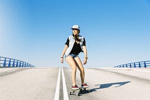 Beautiful woman riding on her board.