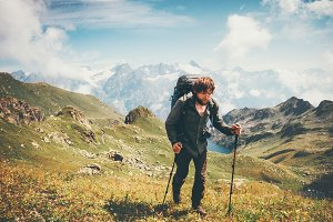 Man mountaineering with backpack