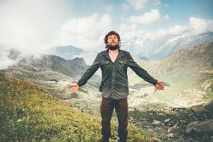 Happy Man meditating in mountains
