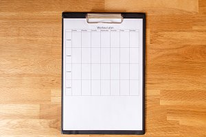 Personal workout plan on wooden background