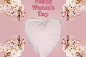 Happy Womens Day background with heart and blossoms
