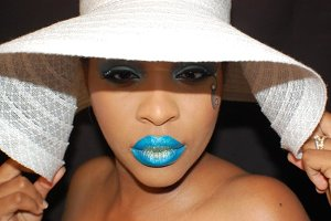 Blue lips, black woman with a hat
