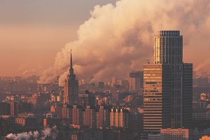 Morning cityscape with smoke