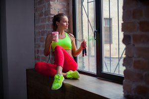 beautiful young girl is drinking a fitness smoothie. Healthy lifestyles concept.