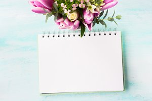 Blank notebook white page with purple pink flowers