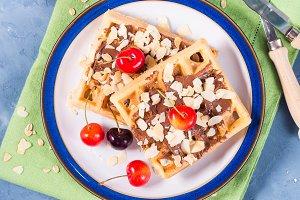 Sweet belgian waffles with chocolate almond cherries