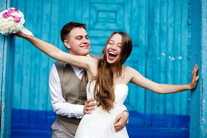 Young wedding couple having fun