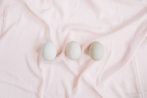 Eggs on pink textile