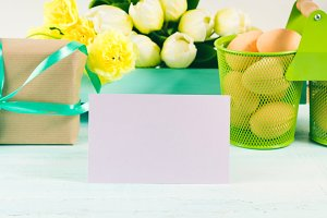 Happy Easter pastel green yellow background gift tulips card