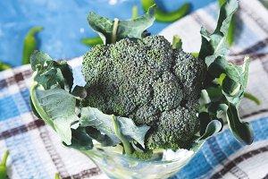 Raw green fresh broccoli vegetable on napkin