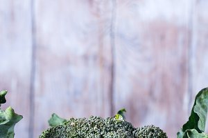 Raw green fresh broccoli vegetable on wooden background