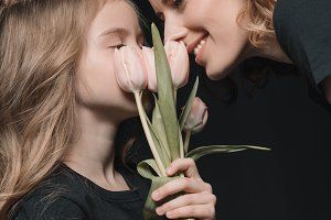 daughter and mother with tulips
