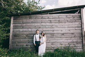 newlyweds and wooden house