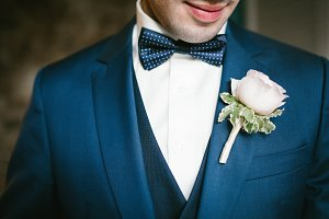 Groom in a blue suit with a bow tie