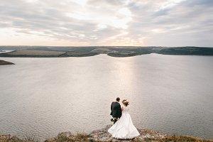 Newlyweds on their amazing sunset