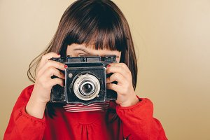 Little retro photographer with an ol