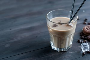 Coffee with milk and ice in glass