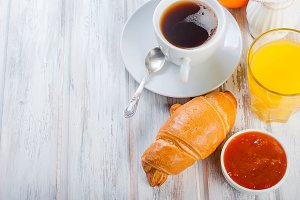 Healty breakfast croissant, jam,