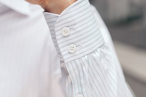 Close up of a businessman showing a shirt cuff